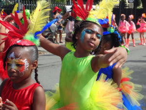 School children dance down King Street during the 2016 Children's Parade. This year the Children's Parade will be merged with the Adult Parade. (Susan Ellis photo)