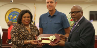 Paradise Jam founder Nels Hawkinson, center, receives the Key to the Territory from Tourism Commissioner Beverly Nicholson-Doty, and Senate President Myron Jackson.