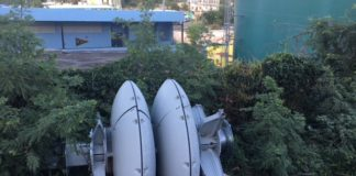 A tsunami warning siren, toppled by September's storms, lied in the bushes.
