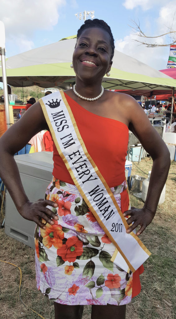 Nemmy Williams-Jackson, Miss I'm Every Woman 2017, poses for a quick photo near busy vendors. (Ivy Hunter photo)