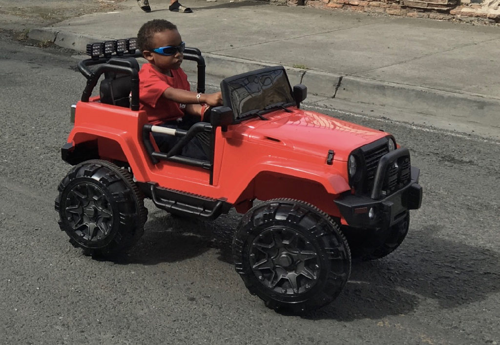 The youngest driver in the parade shows of his jeep. (Ivy Hunter photo)