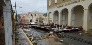 Debris blocks King Street in Christiansted in front of the Florence Williams Library Wednesday morning.