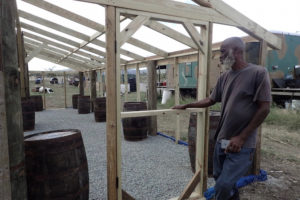 Dale Browne of Sejah Farms shows of his new nursery/greenhouse being built with the help of volunteers. (Susan Ellis photo)
