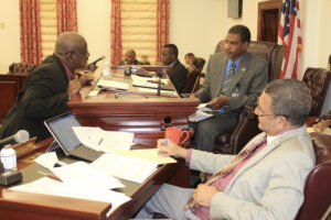 Sens. Neville James, Kurt Vialet and Jean Forde at a Committee on Finance hearing Tuesday.