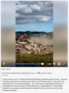 A screenshot taken from a Facebook video post shows dust from a hurricane debris processing site next to the outdoor pool at the St. Thomas Swimming Association, Inc.