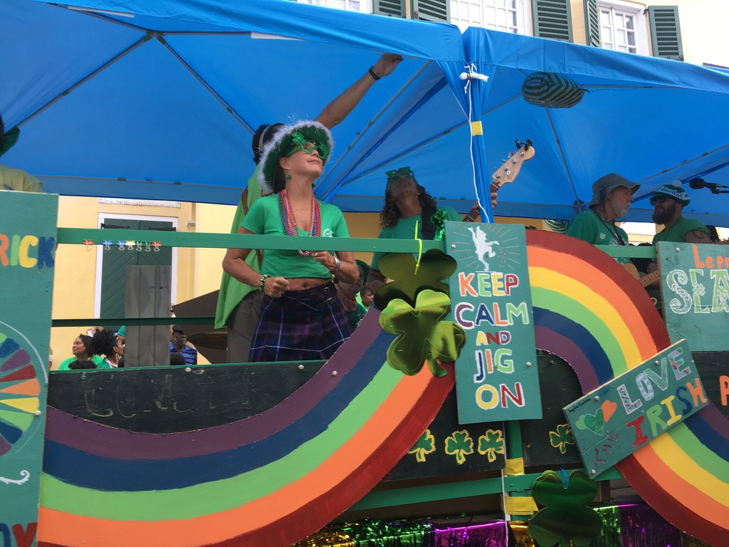 A float showcases the parade theme 'Repairing the Rainbow.' (Ivy Hunter photo)