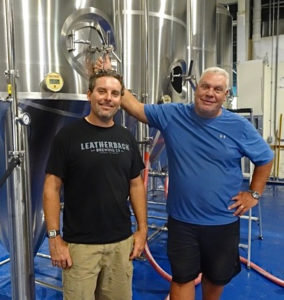 Aaron Hutchins and John Giannopoulos display some of the equipment that will soon be producing craft beer on St. Croix. (Anne Salafia photo)