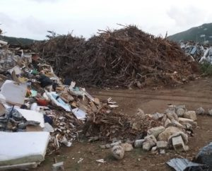 Storm debris collected in Coral Bay ball field on St. John.