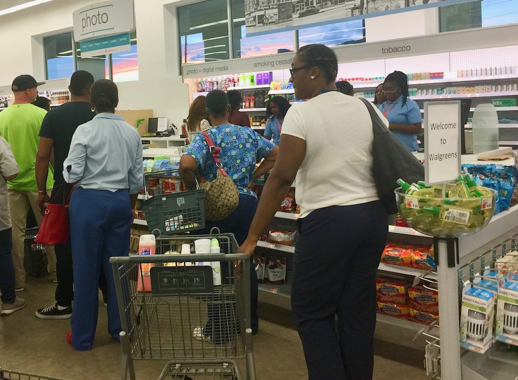 Customers line up at the checkout Monday at the re-opening of Walgreens on St. Thomas. (Kelsey Nowakowski photo)