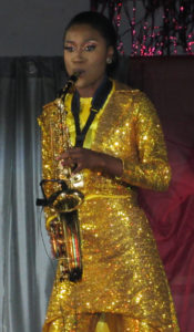 Jahnique Francis plays saxophone in the talent segment.