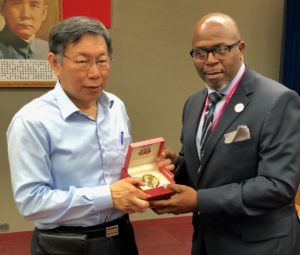 Sen. Myron Jackson presents a V.I. centennial clock to the mayor of Taipei.