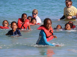 The first set of swimmers, in the 5-to-8 age group, heads for the shore.