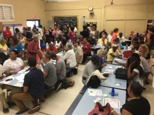 The cafeteria of the Julius E. Sprauve School fills up with St. John residents for the meeting of the Recovery and Resilience Task Force.