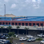 Workers repair the roof of the Cyril E. King Airport. (VIPA photo)