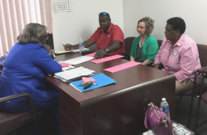 From left, V.I. Supervisor of Elections Caroline Fawkes, Business Development Manager of ES&S Willie Wesley Jr., BVI Supervisor of Elections Juliette Penn; and Sheri Menges of ES&S, meet on Tortola. (V.I. Elections Office photo)