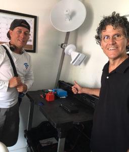 Matt Gyuraki and Morgan Barlas show off a prototype of a Power Pod.