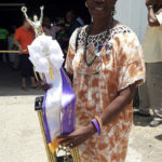 Linda Lacy Hodge holds her Farmer of the Year trophy Saturday at Agrifest. (Facebook photo)