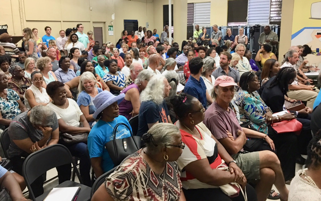 An overflow crowd fills the cafeteria at the Julius E. Sprauve School Tuesday for a town hall meeting with Gov. Kenneth Mapp.