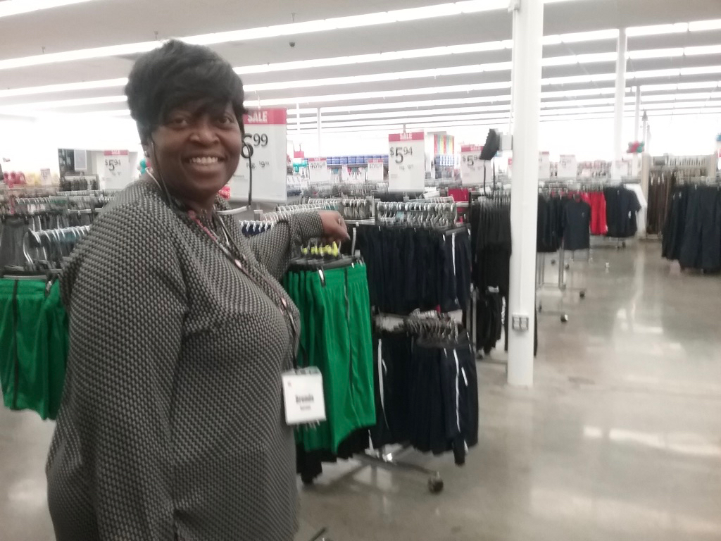 Kmart manager Brendda Burrows looks out over the Tutu Park store after its grand reopening.