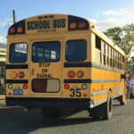 A school bus picks up students at a St. Croix school in 2017. (Ivy Hunter photo)