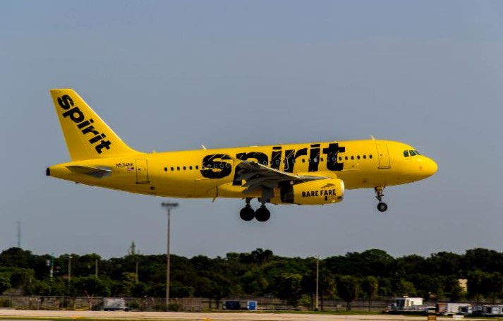 A Spirit Airlines jet flies over the tarmac. (Source file photo)