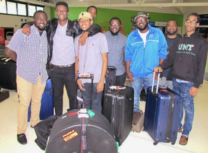 Eight young V.I. musicians return to the Cyril E. King Airport from Maine, where they had been immersed in a week of jazz.