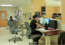 Staff nurses monitor the intensive care unit.