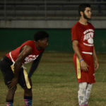 Canes running back Yohance Hanley, left, waits for the signal from quarterback Sebastian Silva and Saturday at Lionel Roberts Stadium. (James Gardner photo)