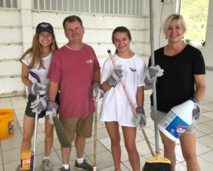 Dr. Mary Dobson Collier and her family, from Baton Rouge, Louisiana, help clean up and prepare youth camp at John Folly Learning Institute as volunteers coordinated through the St. John Culture & Heritage Foundation, Inc.