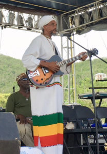 Haile Israel performs for the St. John audience.