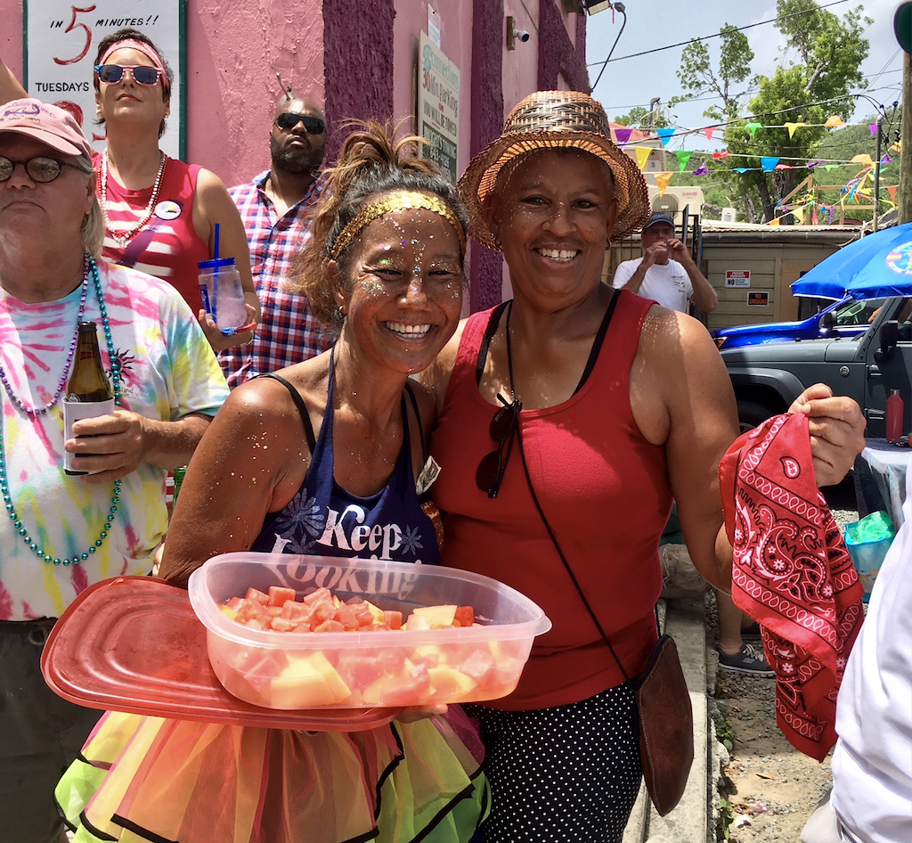 Jodi Tanino and Wanda Burgos enjoy some cooling fresh fruit. (Amy Roberts photo)
