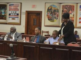 Sen. Alicia Hansen encourages testifier Kristen Greenaway as, from left, Deputy Chief Public Defender Hannibal O'Bryan and Attorney General Claude Walker wait their turn to testify. (Photo by Barry Leerdam, V.I. Legislature)