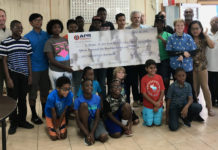 Members of the St. Thomas St. John Youth Scholastic Chess Club join officials of APR Energy and the V.I. Water and Power Authority during a check presentation ceremony Saturday at the Charlotte Amalie High School.