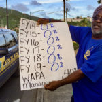 A WAPA employee's placard shows the zero percent raises he and his fellow workers have gotten in the last six years.