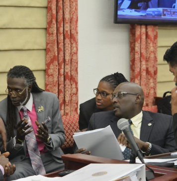 Members of the V.I. Legislature consult during Friday's session on St. Thomas. (Photo by Barry Leerman for the V.I. Legislature)