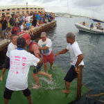 Volunteers help a swimmer out of the water during the 2016 St. Croix Triathlon. (Photo from gotostcroix.com)