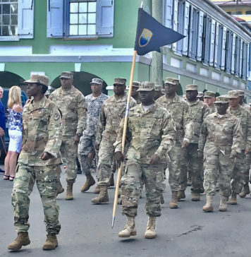 Members of the V.I. National Guard parade through Christiansted.