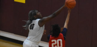 Aliyah Boston blocks a shot, one of nine she blocked during Wednesday's Rock City Jam.