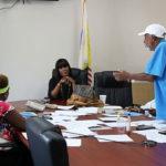 Deputy Elections Supervisor Kevermay Douglass listens to concerns from Board members Lydia Hendricks, left and chairman Arturo Watlington, Jr.