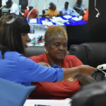 Deputy Elections Superviser Kevermay Douglas and Elections Board member Lydia Hendricks begin the count Tuesday.