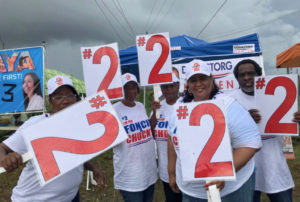 On St. Croix, adherents of the candidates line the streets outside the polling site at Juanita Gardine School.