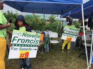 Supporters of Novelle Francis campaign for their candidate outside Juanita Gardine School.