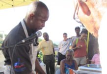 Chef Ashley Allen explains the finer points of carving a turkey during the St. Thomas-St. John Ag Fair.