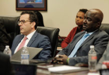 IGY CEO Tom Mukamal, left, and VP of Corporate Services Charles Irons testify before the EDC Tuesday.