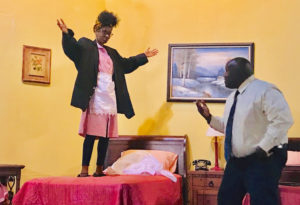 Camae, played by Diana Prince, dons King's jacket and shoes and delivers her oratory to Martin Luther King Jr., played by Lionel C. Downer, in the CCT production of 'The Mountaintop.' (Elisa McKay photo)