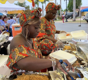 The ladies at the Goodies table serve hot dinners to delighted food fair attendees Wednesday in Frederiksted's  Buddhoe Park.