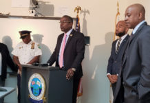 From left, St. Croix Chief of Detectives Naomi Joseph, St. Croix District acting Police Chief Edmond Walters, Gov. Albert Bryan Jr., acting Police Commissioner Jason Marsh and Government House Communications Director Richard Motta Jr. at Tuesday's press conference in Frederiksted. (Melody Rames photo)