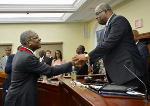 Gov. Albert Bryan Jr., left, shakes hands with Senate President Kenneth Gittens before delivering his first State of the Territory Address. (Photo by Barry Leerdam)