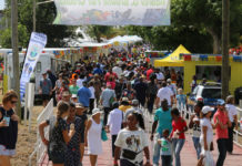 People crowd across the entry bridge to the food booths and other delights as the first day of AgriFest goes into high gear. (Linda Morland photo)