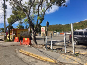 A barrier closes the entrance to parking lot at the Victor Sewer Marine Facility across from the post office in Cruz Bay.